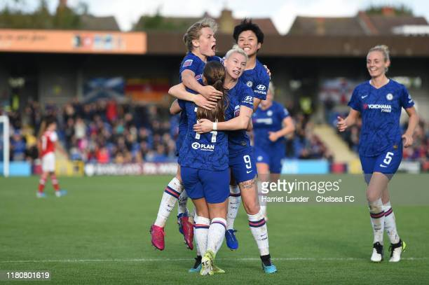 Bethany England of Chelsea celebrates with teammates after scoring her team's first goal during the Barclays FA Women's Super League match between...