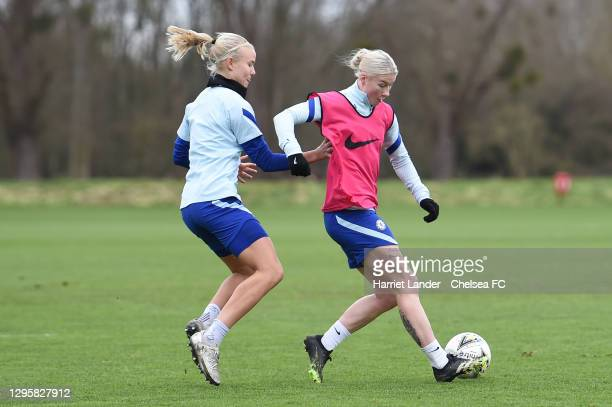 Bethany England of Chelsea is challenged by Pernille Harder of Chelsea during a Chelsea FC Women's Training Session at Chelsea Training Ground on...