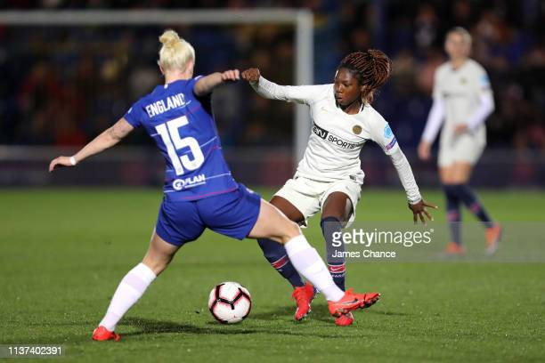 Bethany England of Chelsea tackles Aminata Diallo of PSG during the UEFA Women's Champions League Quarter Final First Leg match between Chelsea Women...