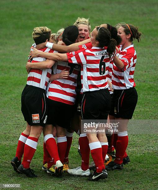 Bethany England of Doncaster Rovers Belles Ladies FC is mobbed by her team-mates after scoring her side's first goal during the FA WSL Continental...