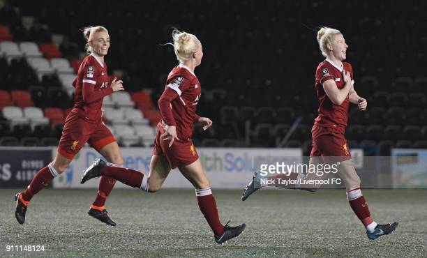 Bethany England of Liverpool Ladies celebrates scoring her second goal of the game with team mates Sophie Ingle and Ashley Hodson during the...