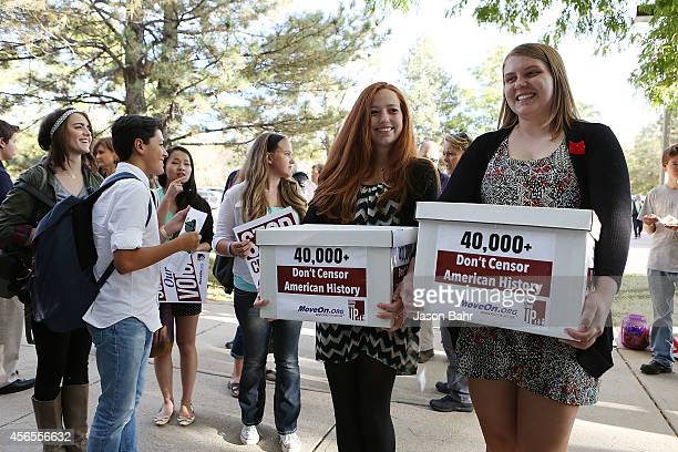 Bethany Keupp and Jocelyn Wallen stand with thousands of signed petitions during a protest at JEFFCO Public Schools on October 2 2014 in Golden...