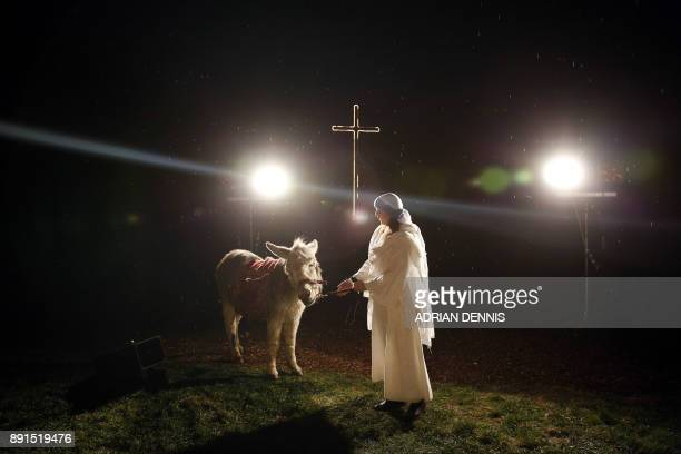 Bethany Lickess performs the role of Mary during the dress rehearsal of The Wintershall Nativity the annual nativity play performed in a barn on the...