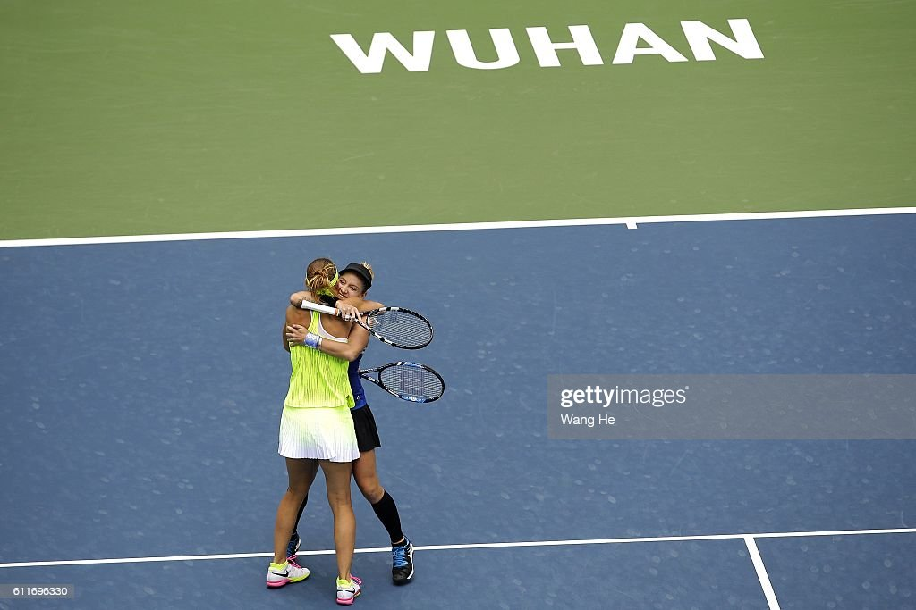 Bethany Mattek Sands of USA and Lucie Safarova of Czech celebrates after they won the doubles final match against Santa Mirza of India and Barbora Strycova of Czech on day 7 of the 2016 Dongfeng Motor Wuhan Open at the Optics Valley International Tennis Center on October 1, 2016 in Wuhan, China.