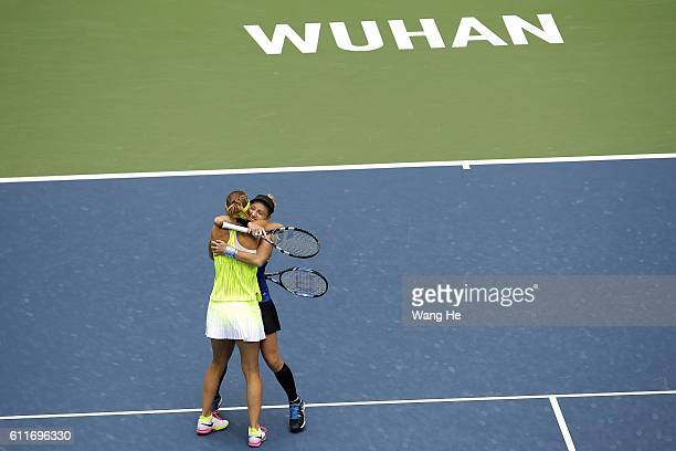 Bethany Mattek Sands of USA and Lucie Safarova of Czech celebrates after they won the doubles final match against Santa Mirza of India and Barbora...