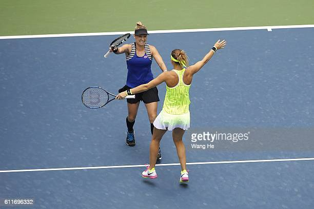 WUHAN CHINA OCTOBER Bethany Mattek Sands of USA and Lucie Safarova of Czech celebrates after they won the doubles final match against Santa Mirza of...