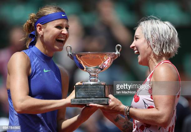 Bethany Mattek-Sands of United States and Lucie Safarova of Czech Republic pose with the trophy after their victory over Ashleigh Barty and Casey...