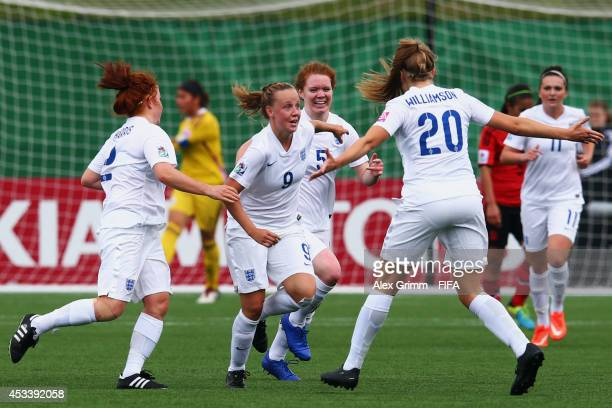 Bethany Mead of England celebrates her team's first goal with team mates during the FIFA U20 Women's World Cup Canada 2014 group C match between...