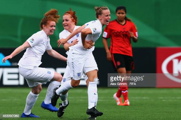Bethany Mead of England celebrates her team's first goal with team mates Martha Harris and Aoife Mannion during the FIFA U20 Women's World Cup Canada...