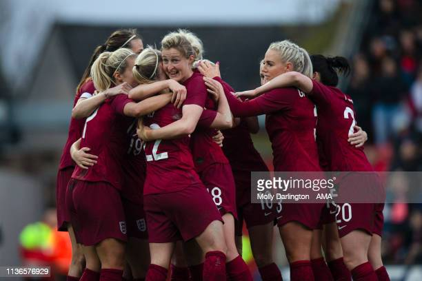 Bethany Mead of England celebrates with team mates after scoring a goal to make it 10 during the International Friendly between England Women and...