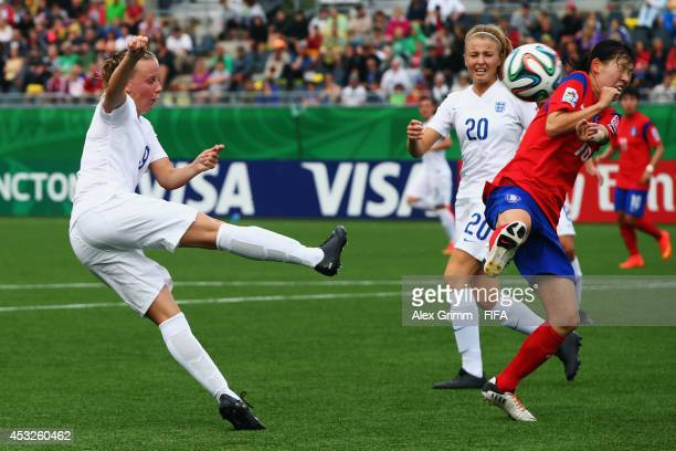 Bethany Mead of England tries to score against Ha Eunhye of Korea Republic during the FIFA U20 Women's World Cup Canada 2014 group C match between...