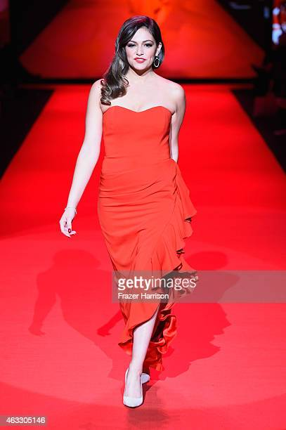 Bethany Mota walks the runway at the Go Red For Women Red Dress Collection 2015 presented by Macy's fashion show during MercedesBenz Fashion Week...