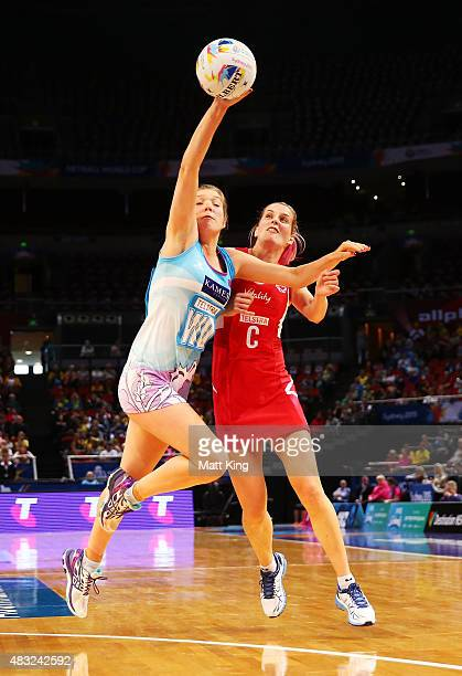 Bethany Sutherland of Scotland competes with Jade Clarke of England during the 2015 Netball World Cup match between England and Scotland at Allphones...