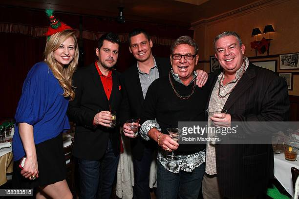Bethany Watson Alex Carr Uncle Johnny and Elvis Duran attend Elvis Duran Morning Show Holiday Party at Carmine's on December 14 2012 in New York City