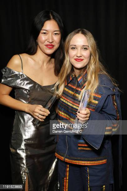 Bethany Williams and Rejina Pyo backstage stage during The Fashion Awards 2019 held at Royal Albert Hall on December 02, 2019 in London, England.