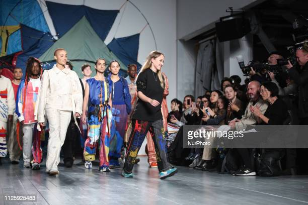 Bethany Williams walks the runway with her models at the show during London Fashion Week February 2019 at the BFC show space on February 19, 2019 in...