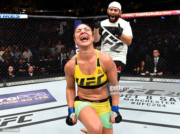 Bethe Correia of Brazil celebrates after defeating Jessica Eye in their women's bantamweight bout during the UFC 203 event at Quicken Loans Arena on...