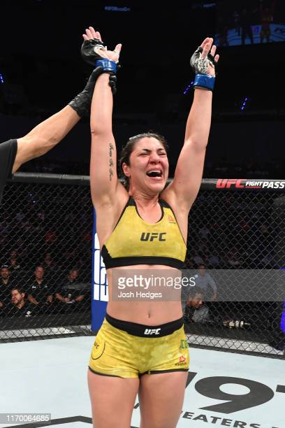 Bethe Correia of Brazil celebrates her victory over Sijara Eubanks in their women's bantamweight bout during the UFC Fight Night event on September...