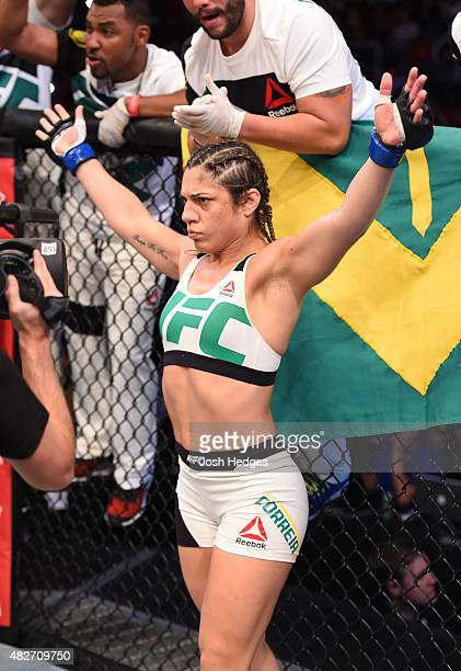 Bethe Correia of Brazil enters the Octagon before facing Ronda Rousey of the United States in their UFC women's bantamweight championship bout during...