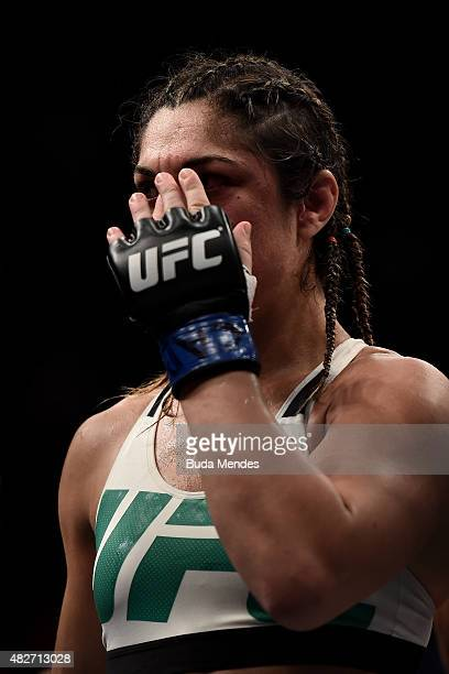 Bethe Correia of Brazil looks on after being defeated by knock down in her bantamweight title fight against Ronda Rousey of the United States during...