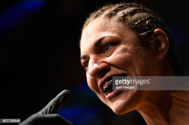 Bethe Correia of Brazil prepares to enter the Octagon prior to facing Jessica Eye in their women's bantamweight bout during the UFC 203 event at...