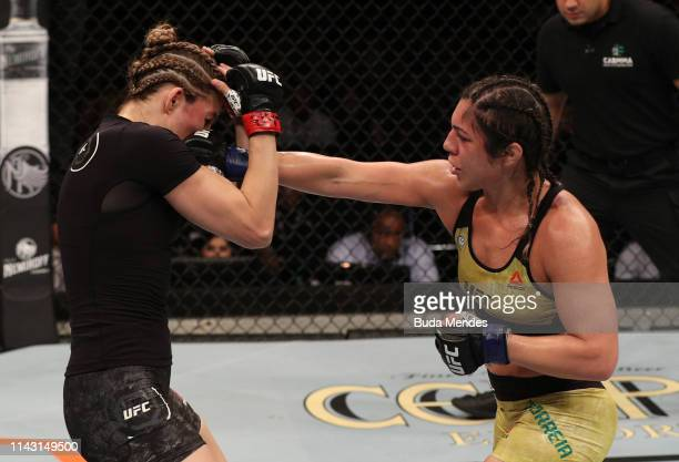 Bethe Correia of Brazil punches Irene Aldana of Mexico in their women's bantamweight bout during the UFC 237 event at Jeunesse Arena on May 11 2019...