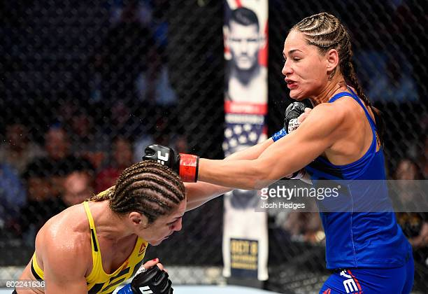 Bethe Correia of Brazil punches Jessica Eye in their women's bantamweight bout during the UFC 203 event at Quicken Loans Arena on September 10 2016...
