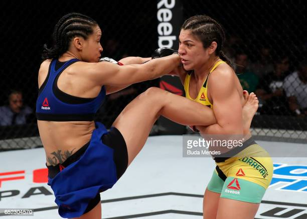 Bethe Correia of Brazil punches Marion Reneau in their women's bantamweight bout during the UFC Fight Night event at CFO Centro de Formaco Olimpica...