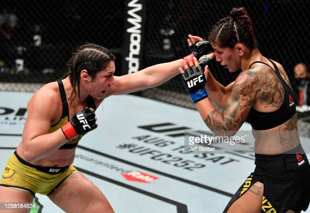 Bethe Correia of Brazil punches Pannie Kianzad of Iran in their bantamweight fight during the UFC Fight Night event inside Flash Forum on UFC Fight...