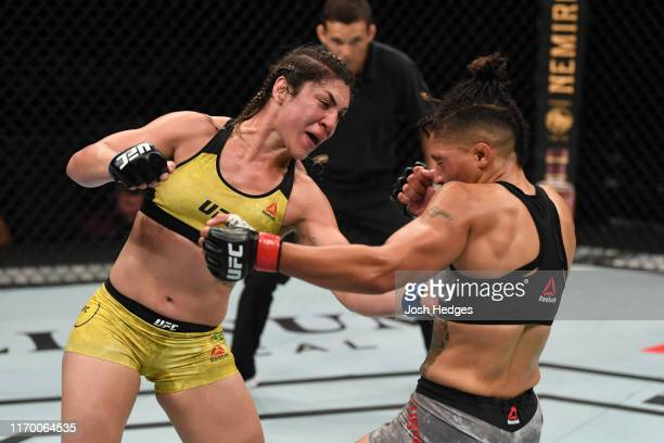 Bethe Correia of Brazil punches Sijara Eubanks in their women's bantamweight bout during the UFC Fight Night event on September 21 2019 in Mexico...