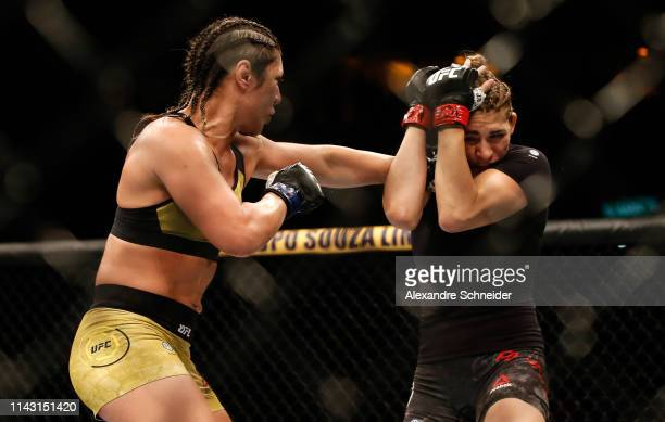 Bethe Correia punches Irene Aldana in their Bantamweight bout during the UFC 237 event event at Jeunesse Arena on May 11 2019 in Rio de Janeiro Brazil