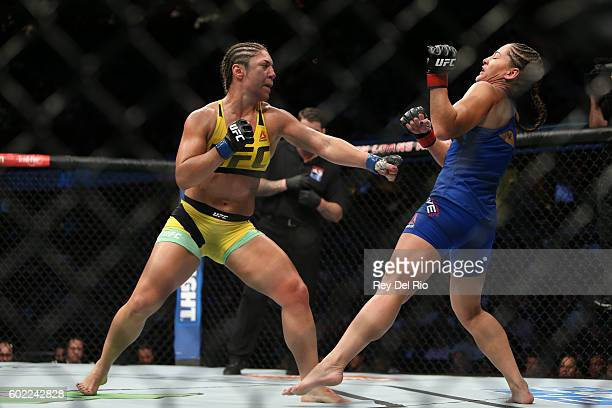 Bethe Correia punches Jessica Eye during the UFC 203 event at Quicken Loans Arena on September 10 2016 in Cleveland Ohio