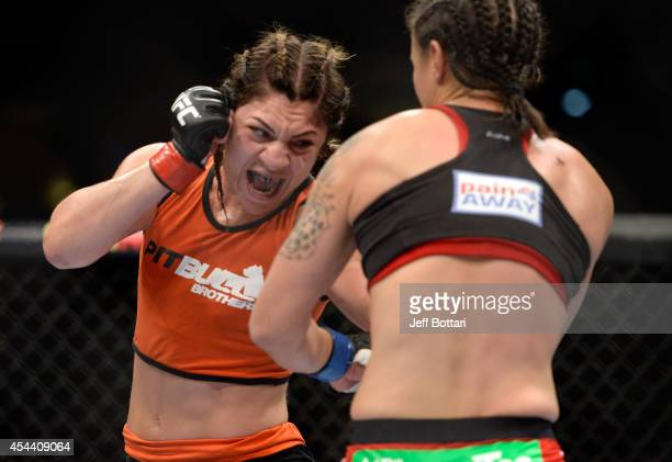Bethe Correia punches Shayna Baszler in their women's bantamweight fight at UFC 177 inside the Sleep Train Arena on August 30 2014 in Sacramento...