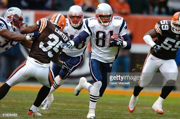 Bethel Johnson of the New England Patriots returns the opening kickoff for a touchdown against the Cleveland Browns at Cleveland Browns Stadium...