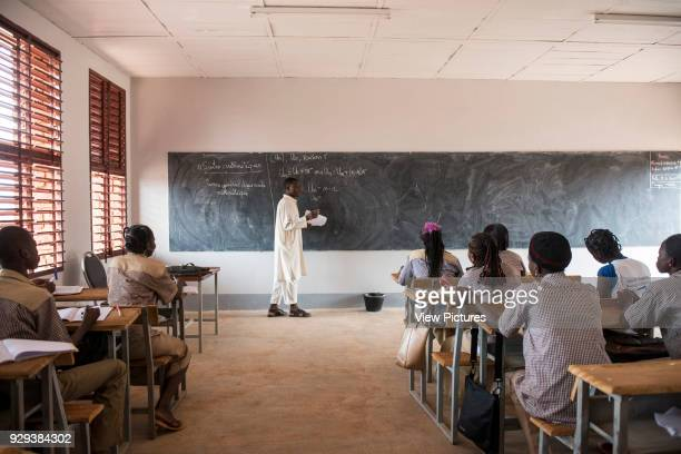 Bethel School, Gourcy, Burkina Faso, Gourcy, Burkina. Architect: Article 25, 2013. Students in the classroom, with teacher at the blackboard.