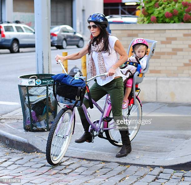 Bethenny Frankel and Bryn Hoppy are seen biking on the West Side Highway on September 25 2013 in New York City