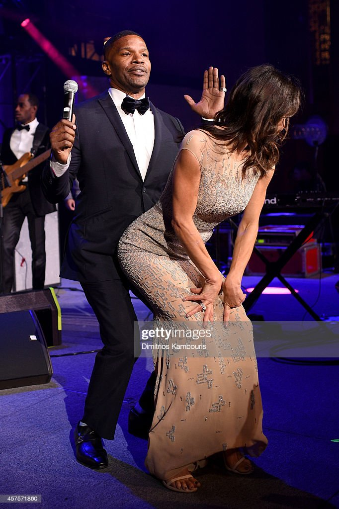 Bethenny Frankel and Jamie Foxx perform on stage at Angel Ball 2014 hosted by Gabrielle's Angel Foundation at Cipriani Wall Street on October 20, 2014 in New York City.
