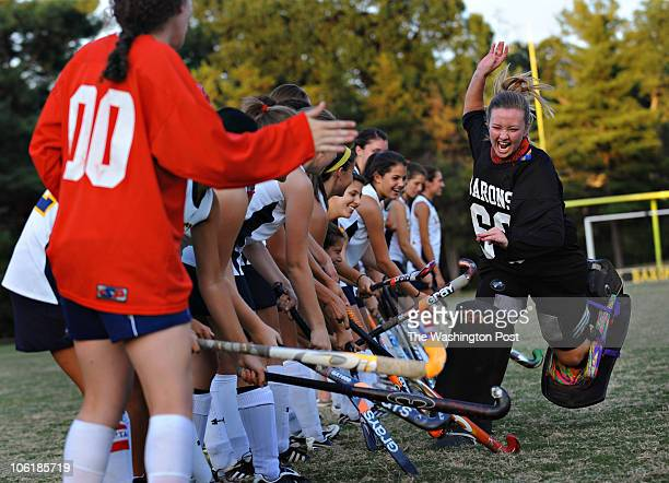 BethesdaChevy Chase goalie Melissa Jaskiewicz right runs past her teammates during introductions before the game at BethesdaChevy Chase High School...