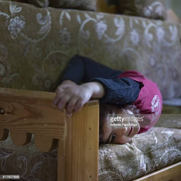 Bethlehem Nour lounging on a sofa in the house of her father Ahmed Moghrabi who was arrested in 2002 and sentenced to 11 life time sentences on...