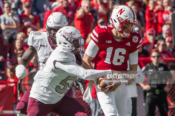 Bethune Cookman Wildcats defensive lineman Todney Evans nearly strips the ball away from Nebraska Cornhuskers quarterback Noah Vedral during the game...