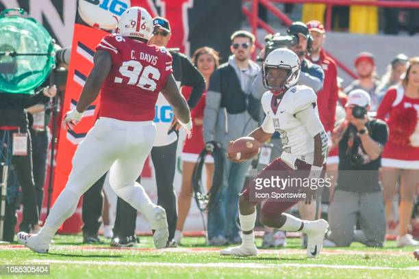 Bethune Cookman Wildcats quarterback David Israel attempts to avoid the tackle of Nebraska Cornhuskers defensive lineman Carlos Davis during the game...