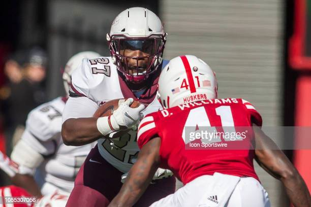 Bethune Cookman Wildcats running back LaDerrien Wilson attempts to navigate a Nebraska defender during the game between the BethuneCookman Wildcats...