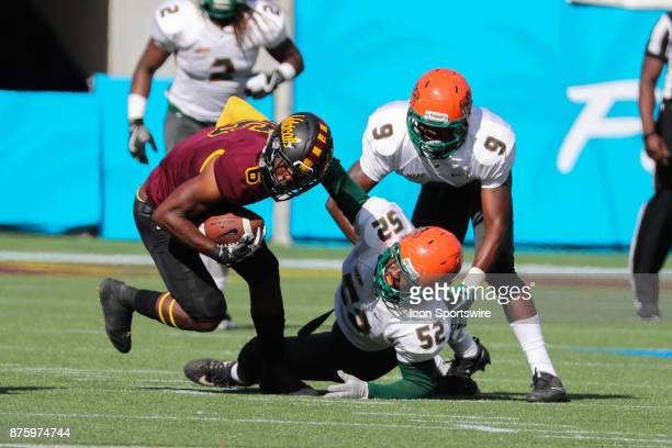 Bethune Cookman Wildcats wide receiver Keavon Mitchell carries the ball and is tackled by Florida AM Rattlers linebacker Derrick Mayweather during...