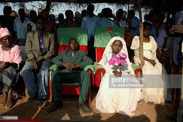 Betino Phipi age 21 sits with Suzana Nabanda age 16 his new wife on August 19 2006 in Mphandula village about 30 miles outside Lilongwe Malawi Mr...