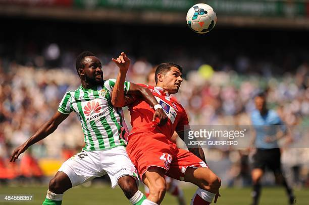 Betis' Congolese midfieder Cedrick vies with Sevilla's midfielder Victor Machin 'Vitolo' during the Spanish league football match Real Betis vs...