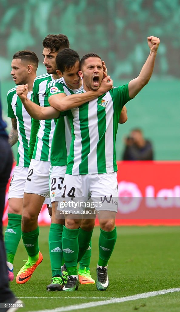 Betis' Danish defender Riza Durmisi (R) celebrates scoring a goal during the Spanish league football match Real Betis vs Sevilla FC at the Benito Villamarin stadium in Sevilla on February 25, 2017. / AFP / CRISTINA