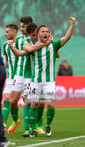 Betis' Danish defender Riza Durmisi celebrates scoring a goal during the Spanish league football match Real Betis vs Sevilla FC at the Benito...