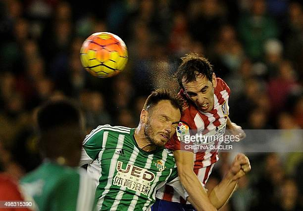 Betis' defender Westermann vies with Atletico Madrid's Uruguayan defender Diego Godin during the Spanish league football match Real Betis Balompie vs...