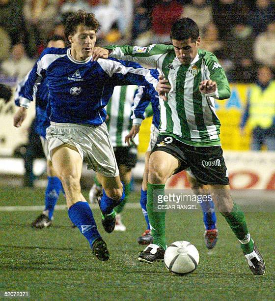 Betis' Fernando Fernandez vies with Gramanet's Pons during a King Cup soccer match in Barcelona 27 January 2005 AFP PHOTO/CESAR RANGEL