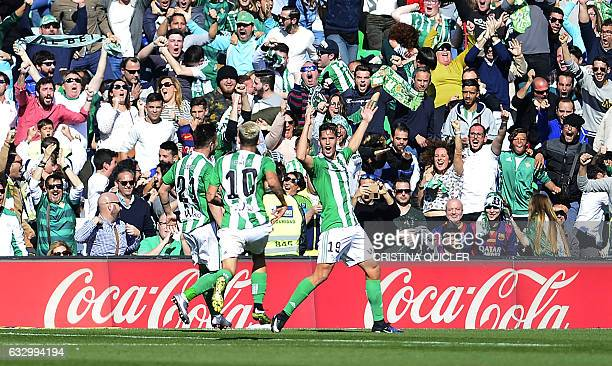 Betis' forward Alex Alegria celebrates after scoring a goal during the Spanish league football match Real Betis vs FC Barcelona at the Benito...